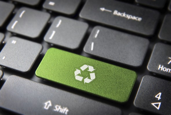 Go green key with wind turbine icon on laptop keyboard. Included clipping path, so you can easily edit it.